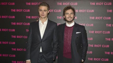 British actors Max Irons, left, and Sam Claflin, right, pose during a photocall for'The Riot Club' french premiere in Paris, Monday, Dec. 1, 2014. (AP Photo/Michel Euler)