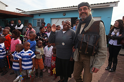 Jeremy Irons shares a tender moment with Rosie Mashale, founder of the Baphumelele orphanage during the 2009 International Achievement Summit in South Africa.