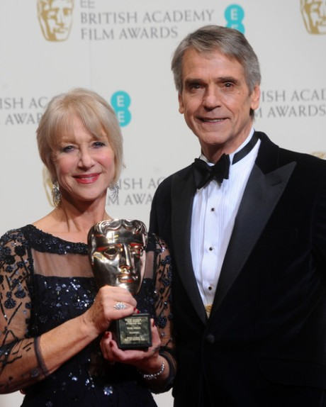 Dame Helen Mirren, winner of the Fellowship award, and actor Jeremy Irons pose in the winners room at the EE British Academy Film Awards 2014 at The Royal Opera House on February 16, 2014 in London, England. (February 15, 2014 - Source: Anthony Harvey/Getty Images Europe)