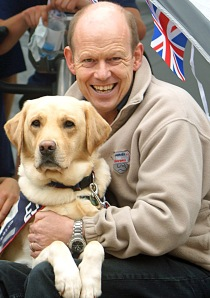 Allen Parton, founder of Hounds for Heroes, with his dog EJ