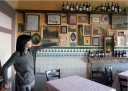 Fabiola Boeretto, owner of the Ristorante San Giulio, shows how the walls of the restaurant have been transformed to make it look as though it's in Portugal.